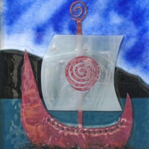 Fused glass panel with Irish Birlinn ship by Irish ceramic and glass artist McCall Gilfillan of Elements Studio, Downhill, Northern Ireland