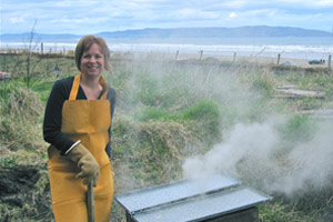 Northern Ireland ceramic artist McCall Gilfillan pit firing by Downhill beach Castlerock