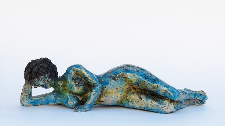 Figurative sculptural raku ceramics by Irish artist McCall Gilfillan laying on side front